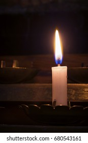 Lighted candle in a Church