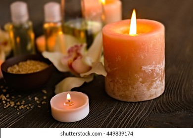 Lighted candles on blurred spa background