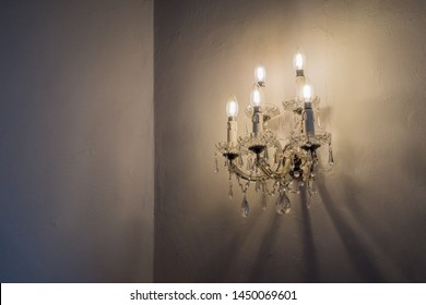 A lighted chandelier in the dark