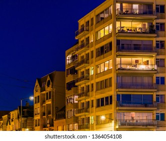 lighted city apartments and buildings by night, Blankenberge, Belgium