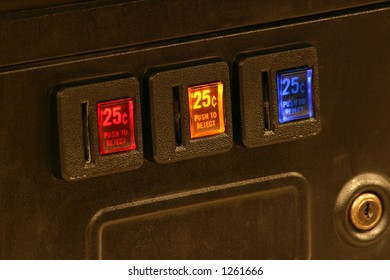 Lighted coin slots of an arcade game machine