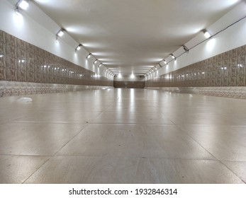 A lighted lonely underpass of a city