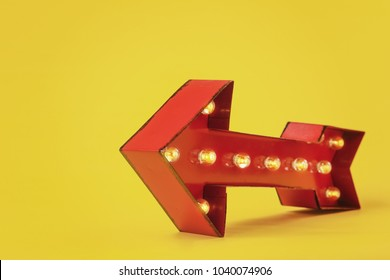 Lighted Red Marquee Arrow on a yellow background