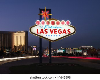 Lighted sign reading Welcome to Fabulous Las Vegas Nevada at dusk. Horizontally framed shot.
