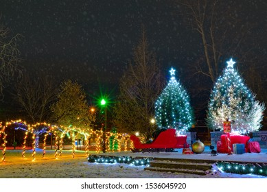 Lighted trees and a tunnel of lights on a town square in Ohio at Christmas
