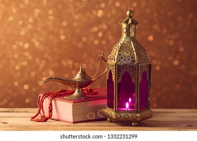 Lightened lantern and book on wooden table over bokeh background. Ramadan kareem holiday celebration concept