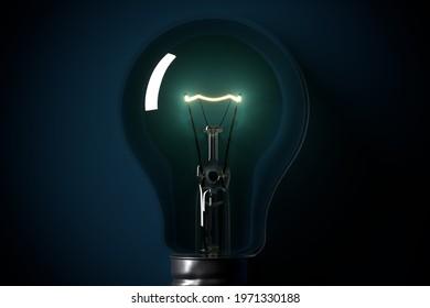 Lightened light bulb on blue background. Lightbulb is symbol of idea, creativity, innovation and similar.
