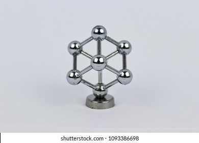 Lightened miniature of Atomium on white background