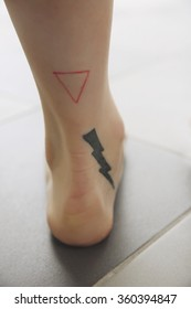 Lightening tattoo on female foot