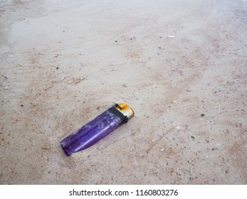 Lighter trashed on the sand beach. Garbage that can be found on Thailand beach.  Pollution problem