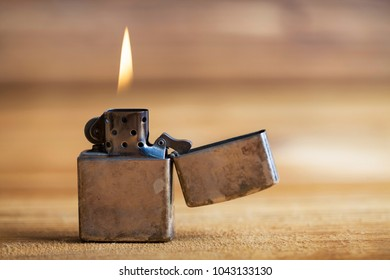 The lighter in the wooden background