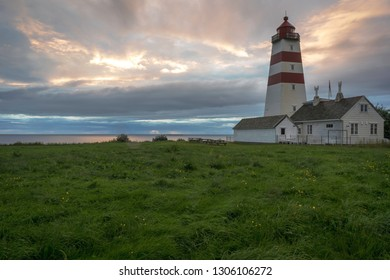 Lighthouse in Aalesund/Norway at sunset. Architecture, lighthouse, sky, clouds, sunset, summer.