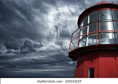 Lighthouse against  stormy sky.