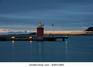 Lighthouse at Alesund and lights passing ship. Norway. Travel. From the series of lighthouses