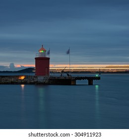 Lighthouse at Alesund and the lights of the ship. Norway. Travel. From the series of lighthouses