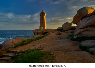 Lighthouse among the red rocks of Perros-Guirec, France