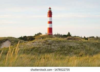 "Lighthouse ""Amrum"" on the dunes at sunset and soft environment"