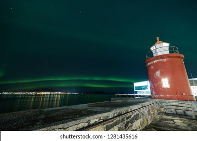 Lighthouse and aurora at port of Aalesund