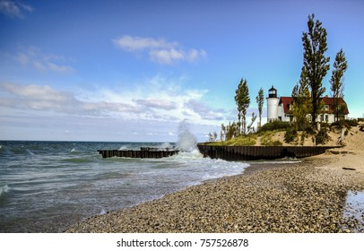 Lighthouse Background. Point Betsie Lighthouse on a windy summer day as waves crash on the rocky coast of Lake Michigan.