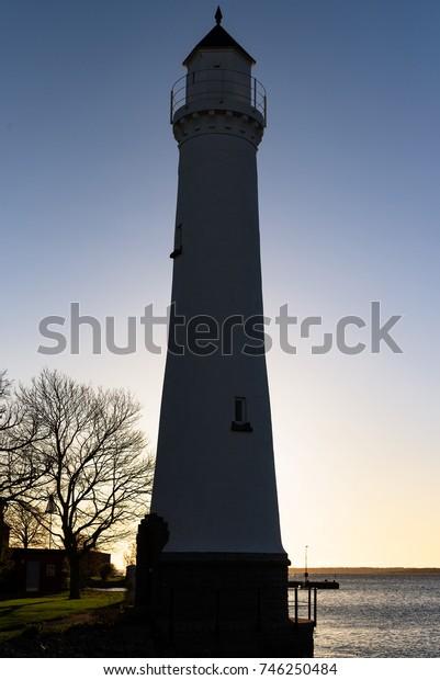 Lighthouse backlit at dawn. Location Stumholmen in Karlskrona, Sweden.