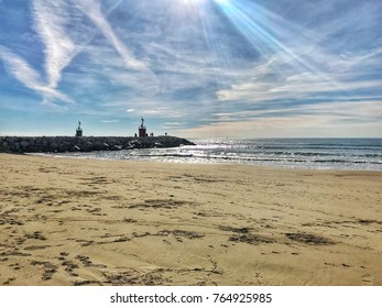 lighthouse and beach with clouds and sun effects lights
