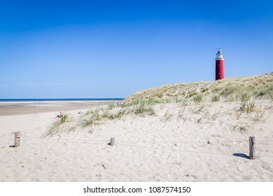 Lighthouse and beach of Texel with a clear blue sky. Texel is the largest wadden island in the Netherlands