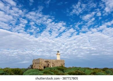 The lighthouse behind the old house in Syracuse Sicily
