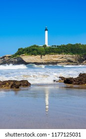 The lighthouse of Biarritz with reflection on the sea. Basque country of France.