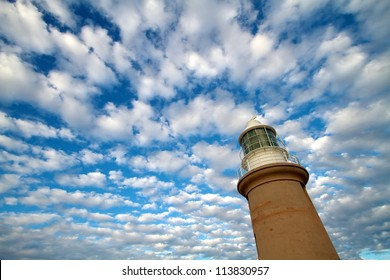 Lighthouse with blue sky and white cloud background