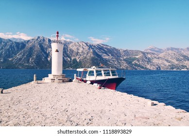 Lighthouse with boat in vintage color with grain at Our lady the rock island Panoramic view at kotor of Montenegro,UNESCO world heritage site