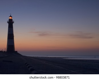 Lighthouse Breskens lighthouse in the Netherlands shining in the evening.