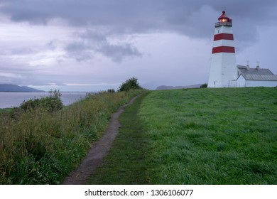 Lighthouse building and path in Aalesund/Norway. Summer, night, evening, holiday, vacation sunset, blue hour concept.
