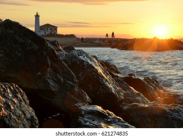 lighthouse by sunrise