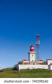 Lighthouse at Cabo da Roca and a blue sky. Sintra, Portugal