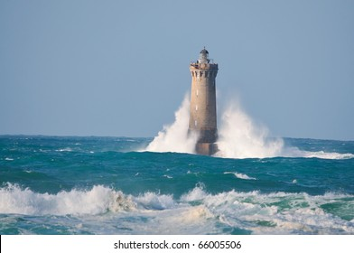"Lighthouse called ""Le phare du four"" in Tremazan in Brittany, France during storm in November"