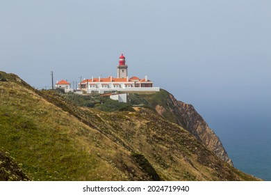 Lighthouse at Cape Roca (Cabo da Roca), most western point of Europe at coast of Atlantic Ocean in Portugal.