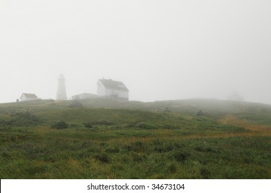 Lighthouse at Cape Spear, Newfoundland in the fog - North America's easternmost point