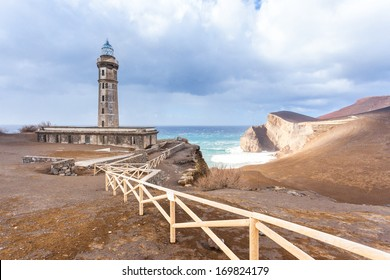 Lighthouse Capelinhos and dramatic landscape on the cliffs of island Faial, Azores islands