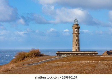 Lighthouse Capelinhos and shore of atlantic ocean on island Faial, Azores islands.