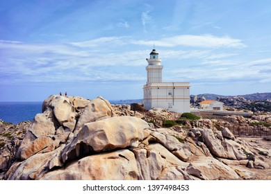 Lighthouse at Capo Testa in Santa Teresa Gallura province on Sardinia island in Italy. At the Mediterranean sea with Rocky mountains.