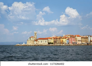 Lighthouse and church in Piran, Slovenia, view from the sea