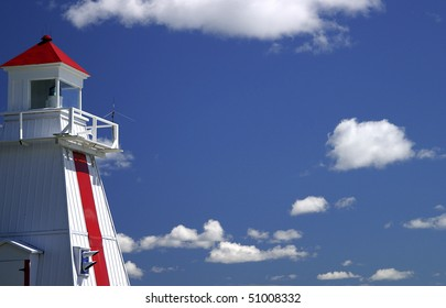 Lighthouse With Clouds On Great Lakes Shore