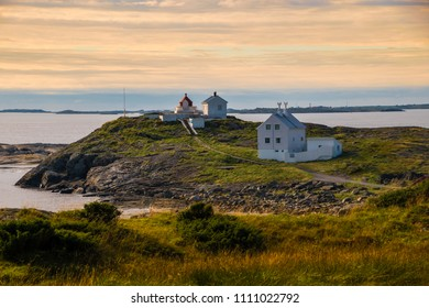 Lighthouse at coast Norway sunset landscape