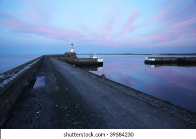 Lighthouse with colorful sky
