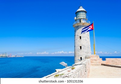 Lighthouse and cuban flag on el Morro castle in Havana with space for text