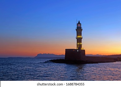 Lighthouse at dawn, old Venetian harbor of Chania, Chania, Crete island, Greece