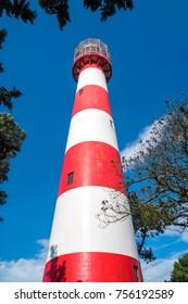 Lighthouse in the daytime on the Black Sea, Georgia Poti. Red and white. Poti, Georgia.