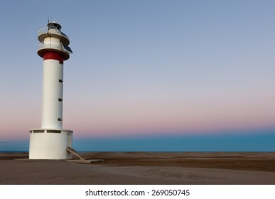 Lighthouse in the Delta del Ebro at sunset