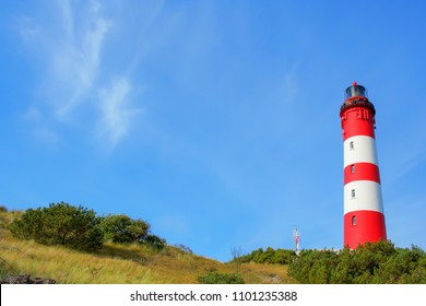 Lighthouse in the dunes of Amrum, North Sea Nature Park, Northern Germany.