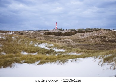 Lighthouse in a dunes landscape in in Amrum Germany.